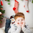Happy smiling little boy near the Christmas tree — Stock Photo #36770437