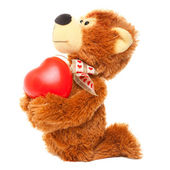 Teddy bear with red heart on white — Stock Photo