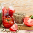 Canned tomatoes and cucumbers in glass jar, homemade preserved v — Stock Photo #37873861