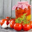 Stock Photo: Homemade tomatoes in glass jar. Fresh and canned tomatoes on woo