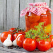 Homemade tomatoes in glass jar. Fresh and canned tomatoes on woo — Zdjęcie stockowe #37874185