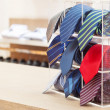 Stock Photo: Set of rolled up neck ties on plastic shelf