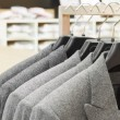 Stock Photo: Men suit jackets in apparel store