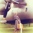 Vintage photo of beautiful girl and plane — Stock Photo