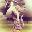 Vintage photo of beautiful girl and plane — Stock Photo #40087327