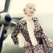 Vintage stylized photo of beauty girl and plane — Stock Photo #40228529