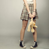 Teenager girl with teddy bear — Stock Photo