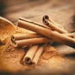 Stock Photo: Vintage stylized photo of Cinnamon sticks and cinnamon powder