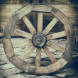 Vintage stylized photo of wooden cart wheel — Стоковое фото