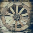 Vintage stylized photo of wooden cart wheel — Stock Photo