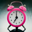 Pink Alarm clock close up — Stock Photo