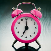 Pink Alarm clock close up — Stock Photo