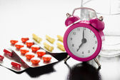 Alarm clock and medical pills — Stock Photo