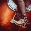 Stock Photo: Jockey riding boot, horses saddle and stirrup