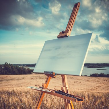 Canvas rests on a easel on lake landscape, retro stylized