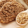 Bread from wheat sprouts and sprouted seeds in spoon on cutting — Stock Photo #43381841