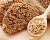 Bread from wheat sprouts and sprouted seeds in spoon on cutting — Stock Photo