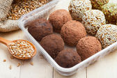 Balls from ground wheat sprouts with sesame, pumpkin seeds and — Stock Photo