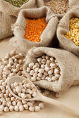 Hessian bag with chickpeas and sack with grains — Stock Photo