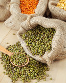 Hessian bag with green mung — Stock Photo