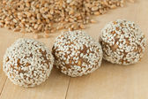 Balls from ground wheat sprouts with sesame seeds — Stock Photo