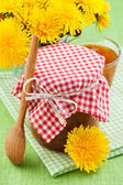 Jar of dandelion jam and blowball flowers — Stock Photo