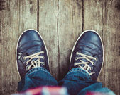 Shoes on wooden floor from above — Stockfoto