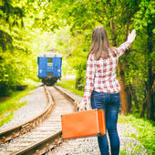 Departing train, young woman waving his hand — Stock Photo