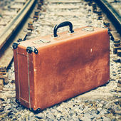 Old suitcase on the railway — Stock Photo