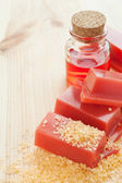 Pink wax for hair removal and roses oil — Stock Photo