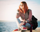 Romantic beautiful young woman with handbag over seascape — Stock Photo