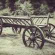 Old wooden cart, vintage stylized photo — Stock Photo