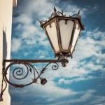 Decorative  wall street lamp on blue sk — Stock Photo #48853401