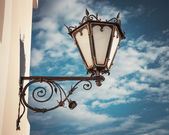 Decorative  wall street lamp on blue sk — Stock Photo
