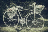 Vintage stylized photo of decorative bicycle — Stock Photo