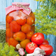 Homemade pickled tomatoes in glass jar. Fresh vegetables, dill a — Stock Photo #50923921
