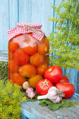 Homemade pickled tomatoes in glass jar. Fresh vegetables, dill a — Stock Photo