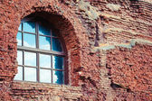Arched window in a old red brick wall — Stock Photo