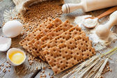 Grain Crispbread, cereal crackers on table — Stock Photo