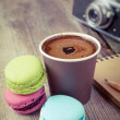 Macaroons, espresso coffee cup, sketch book and retro camera on — Stock Photo #51453325