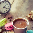 Macaroons, espresso coffee cup, sketch book and alarm clock on w — Stock Photo #51453329