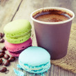 Macaroons and espresso coffee cup  on wooden rustic table — Stock Photo #51453403