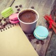 Macaroons, espresso coffee cup, cinnamon sticks and sketch book — Stock Photo #51453483