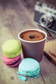 Macaroons, espresso coffee cup, sketch book and retro camera on — Stock Photo