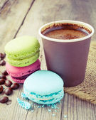 Macaroons and espresso coffee cup  on wooden rustic table — Stock Photo