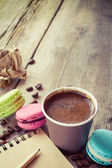Macaroons, espresso coffee cup and sketch book on wooden rustic  — Stock Photo