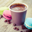 Macaroons and espresso coffee cup on old wooden rustic table — Stock Photo #51565207
