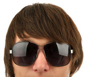 Head of the young man in sunglasses — Stock Photo