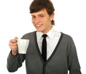 Close-up portrait of young smiling man with a cup — Stock Photo