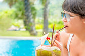 Close-up portrait young pretty woman drinking coconut cocktail  — Stock Photo